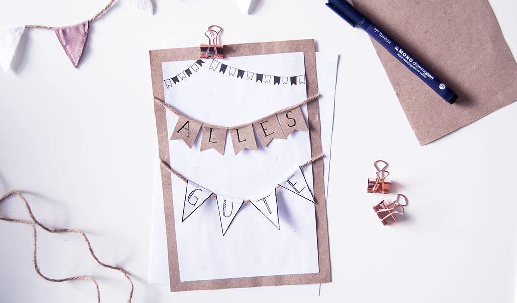 """Geburtstagskarte mit einer Girlande auf der """"Alles Gute"""" steht"""