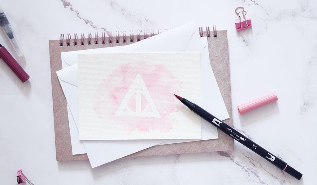 Harry Potter Karte in rosé mit Heiligtümer des Todes Zeichen