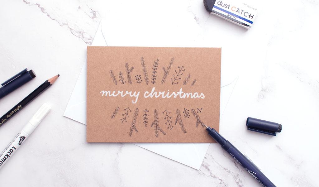 einfache Weihnachtskarte mit Tannenzweigen