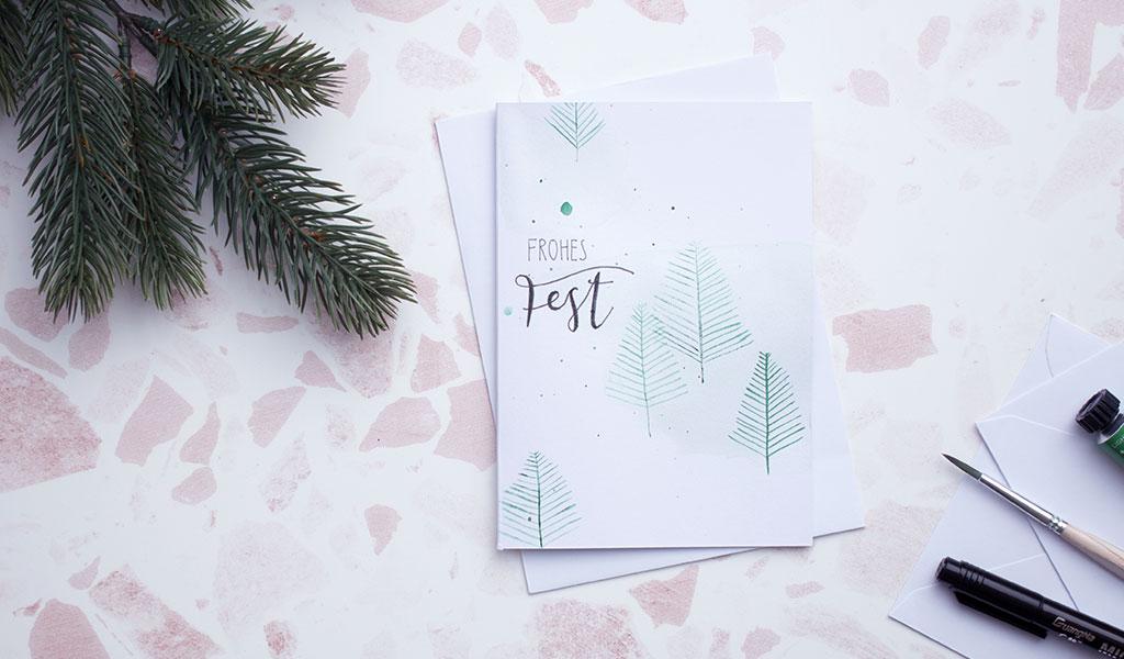 Aquarell Weihnachtskarte mit Tannenbäumen